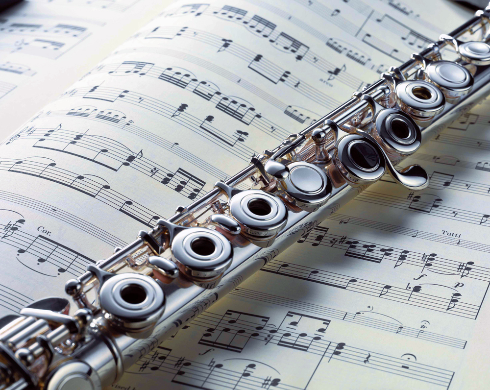 Flute and Music Sheet - Music Makers Calgary